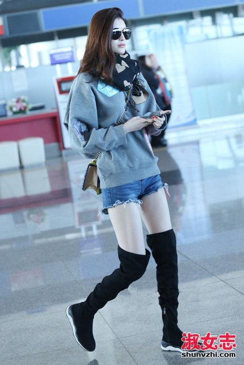 华语女星机场街拍:倪妮裹成球何洁狂露腿 明星机场街拍照